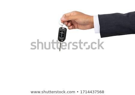Male hand holding a car key . New car concept stock photo © Len44ik