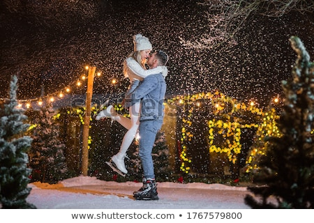 Two couples in winter clothing Stock photo © photography33