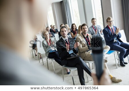 colleagues applauding during a business meeting stock photo © get4net