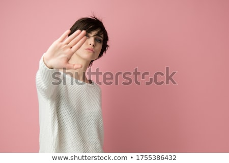 Serious woman making stop hand sign palm gesture Stock photo © stepstock
