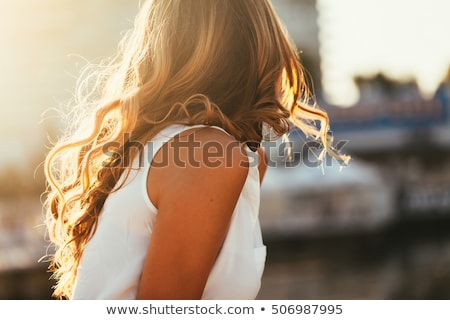beautiful girl with fluttering hair Stock photo © evgenyatamanenko