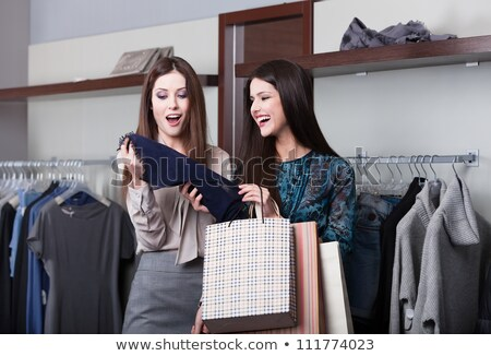 Two young attractive girlfriends go shopping Stock photo © HASLOO