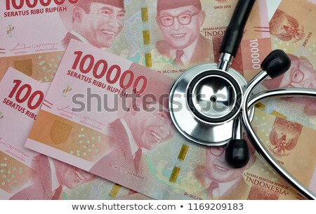 stethoscope on the Indonesia's banknotes  Stock photo © antonihalim