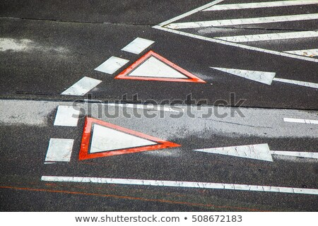 yield sign marked at the street in vienna austria stock photo © meinzahn