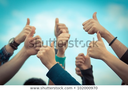 teenagers with thumbs up stock photo © ambro
