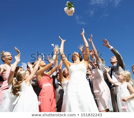 Bride Throwing Bouquet For Guests To Catch Stock photo © monkey_business