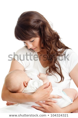 Stock photo: Mother breast feeding her infant