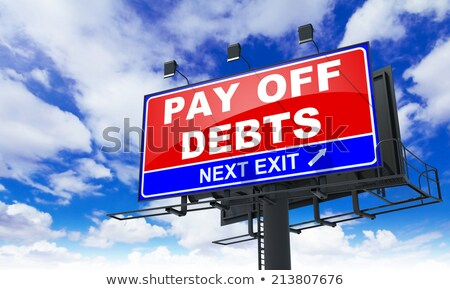 Pay off Debts on Red Billboard. Stock photo © tashatuvango