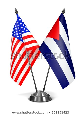 ABD Küba minyatür bayraklar yalıtılmış beyaz Stok fotoğraf © tashatuvango