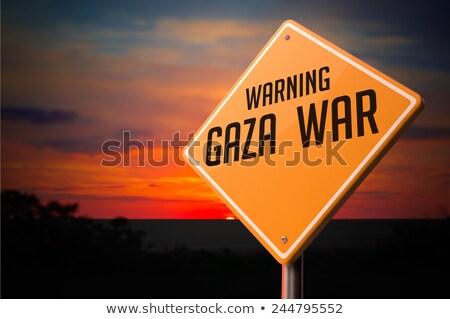 Stockfoto: Oorlog · waarschuwing · verkeersbord · zonsondergang · hemel · achtergrond