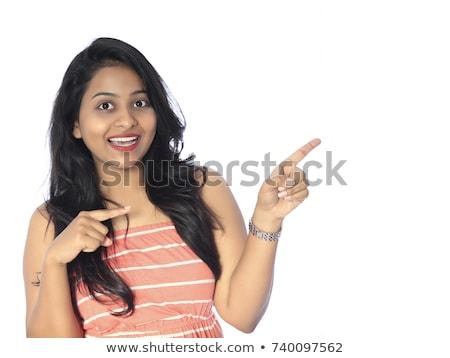 wesoły · młoda · kobieta · wskazując · w · górę · patrząc · biały - zdjęcia stock © hasloo