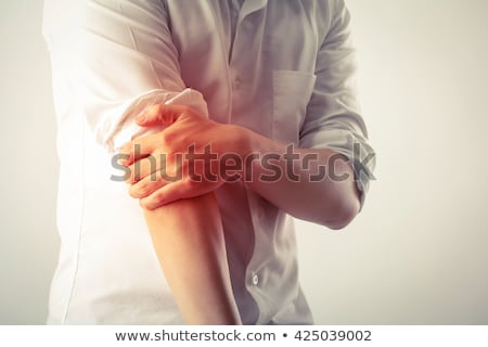 Man Suffering From Elbow Pain Stock photo © AndreyPopov