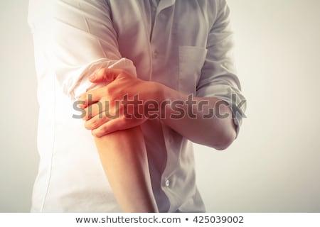 homme · souffrance · coude · douleur · torse · nu · jeune · homme - photo stock © AndreyPopov