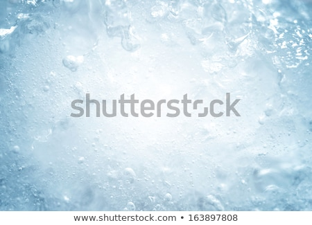 Transparent ice cube in blue colors Stock photo © Fosin