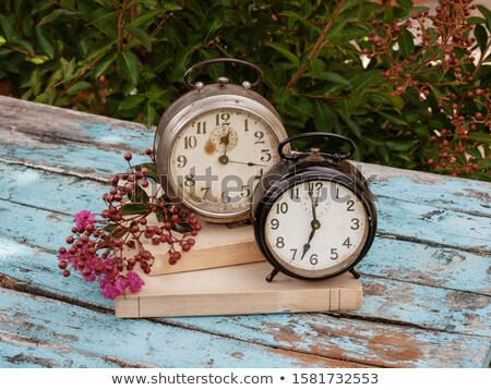 old alarm clock and book on a rustic wooden table Stock photo © nito