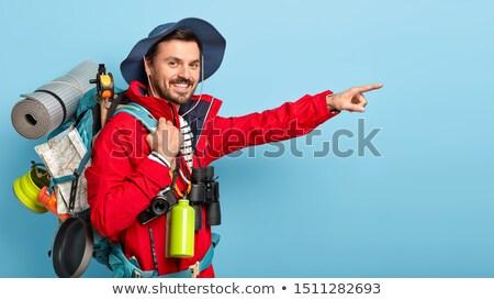 Tourist in a red jacket Stock photo © Kotenko