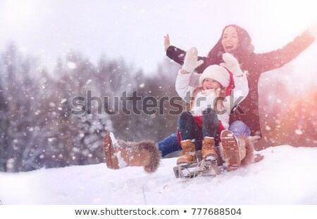 child with sled and mother in park at winter 2 stock photo © paha_l