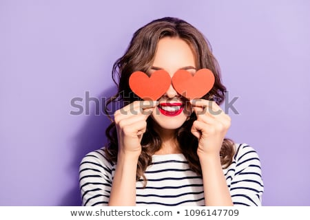Lovely red lips smile of curly woman with white teeth Stock photo © deandrobot