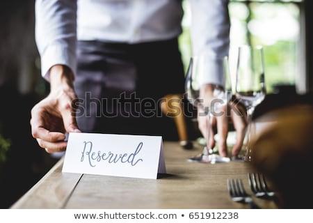 Tablo rezervasyon restoran kitap kalem turuncu Stok fotoğraf © pixpack