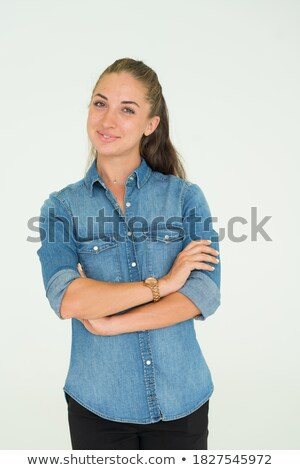 Woman with arms folded leaning on the wall Stock photo © deandrobot
