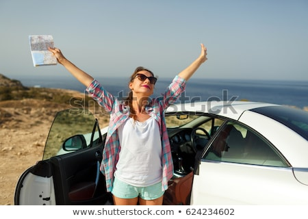 Joyful woman with a map in her hand traveling on a cabriolet Stock photo © vlad_star