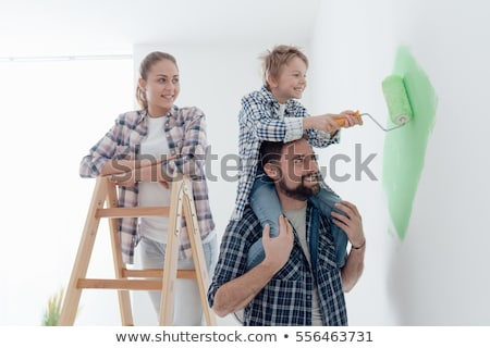 Kids and father with paint rollers and painting ladder Stock photo © ilona75