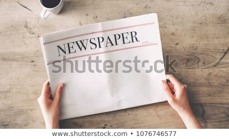 a woman reading a tabloid stock photo © bluering