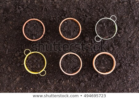 Six neatly arranged planters filled with soil Stock photo © ozgur