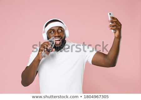 Young man doing sports isolated on the white Stock photo © Elnur