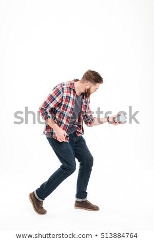 Lezser szakállas férfi hallgat zene játszik Stock fotó © deandrobot