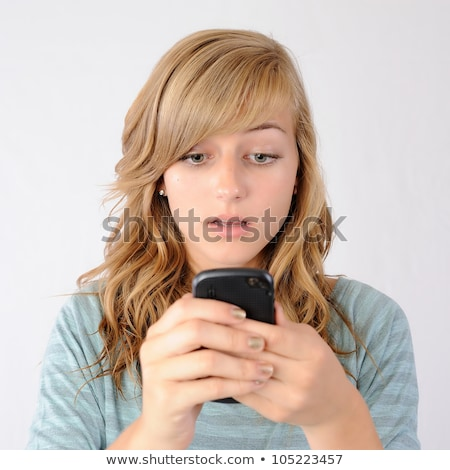 Worried Teenage Girl Standing In Studio stock photo © monkey_business