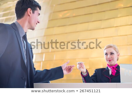 ストックフォト: ホテル · 受付 · チェック · 男 · キー · カード