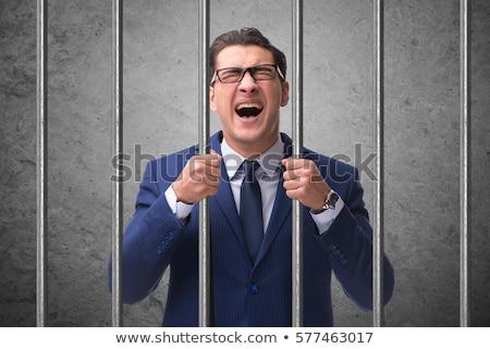 jovem · empresário · atrás · barras · prisão · negócio - foto stock © elnur