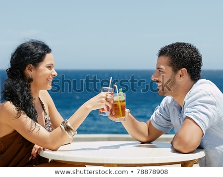 Side view of happy woman sitting near the bar Stock photo © deandrobot