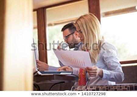 молодые · женщины · рабочих · ноутбука · говорить · телефон - Сток-фото © vlad_star