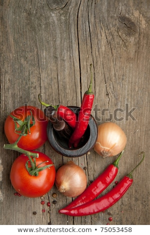 The cherry tomatoes, peppers, chilli on wooden table Stock photo © master1305