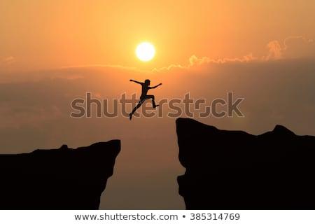hırslı · işadamı · atlama · uçurum · adam · dağ - stok fotoğraf © master1305