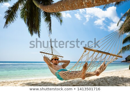 close up of man sleeping in hammock stock photo © wavebreak_media