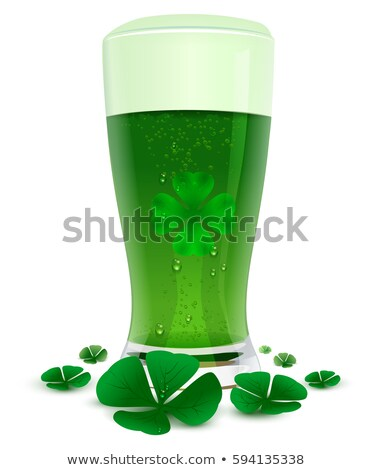 Green drink ale in high transparent glass. Green leaf quatrefoil clover symbol of St. Patricks Day stock photo © orensila