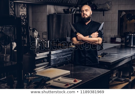 confident male chief cook with arms crossed stock photo © rastudio