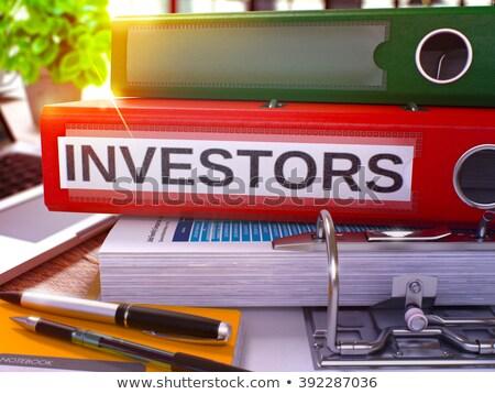 Red Office Folder with Inscription Investors. Stock photo © tashatuvango