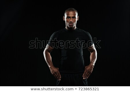 Serious afro american sports man with arms  on his hips looking  Stock photo © deandrobot