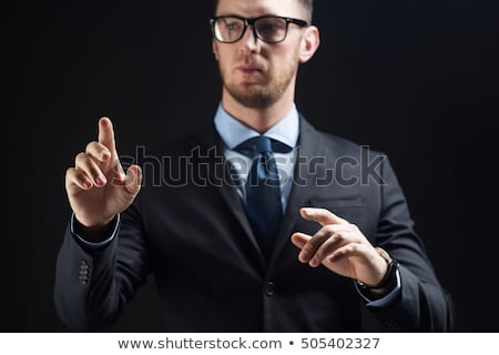 Empresario traje tocar algo invisible gente de negocios Foto stock © dolgachov