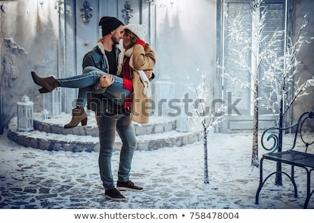 Young couple kissing in street Stock photo © IS2
