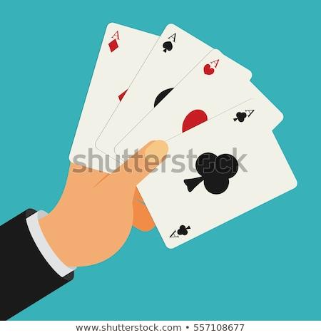 Férfi tart kártyapakli öltöny portré szín Stock fotó © IS2
