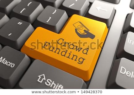 Menigte toetsenbord sleutel hand jonge man Blauw Stockfoto © tashatuvango