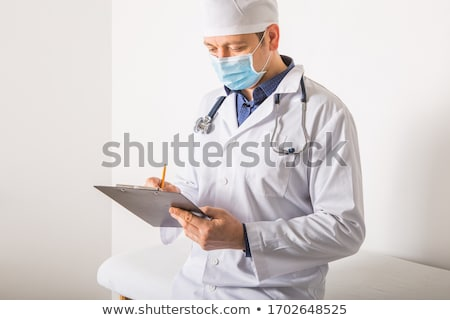 farmacêutico · escrita · prescrição · jovem · médico · vestido - foto stock © RAStudio