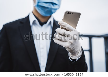 Business man wearing rubber gloves Stock photo © IS2