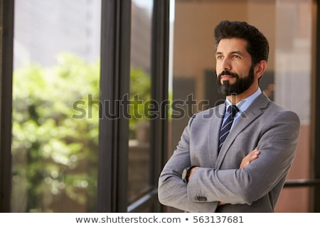 Serious bearded man in business clothes looking at the camera Stock photo © deandrobot