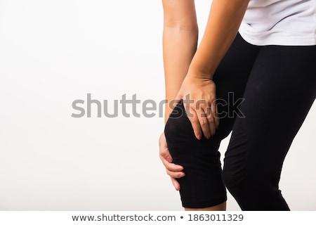Közelkép lövés nő tart sebes térd Stock fotó © Nobilior